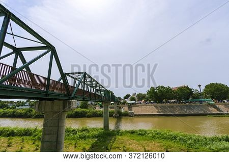 A Pedestrian Bridge Over The Pa Sak River At Satue Temple, Ayutthaya Province In Thailand