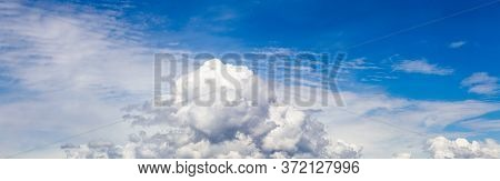 Panoramic View Of Puffy White Clouds With Blue Sky During A Beautiful Sunny Day. Taken Over Vancouve