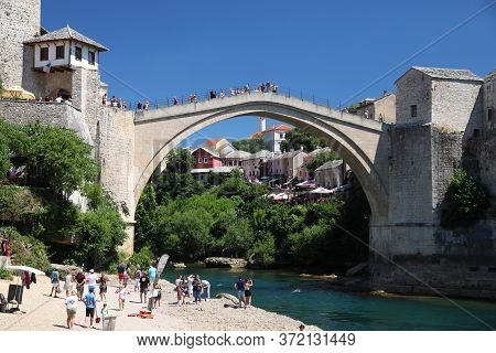 Mostar, Bosnia And Herzegovina - June 29, 2019: People Visit The Old Town Of Mostar. The Area Surrou