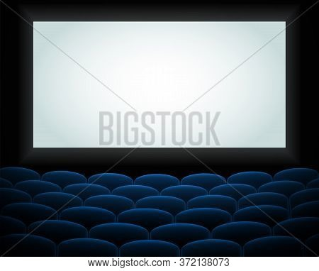 Interior Of A Cinema Movie Theatre, Lecture Hall With Copyspace On The Screen And Rows Of Blue Cinem