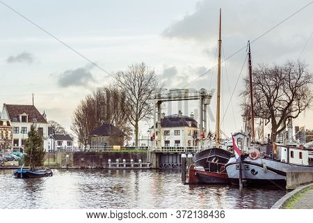 Gouda, Netherlands, December 23 2015: The Ancient Museum Harbor Of Gouda In The Netherlands With Mon
