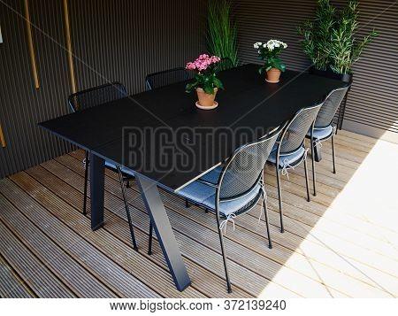 Inside A Beautiful Cozy Glass Backyard Garden Gazebo Pavilion With Outdoors Furniture