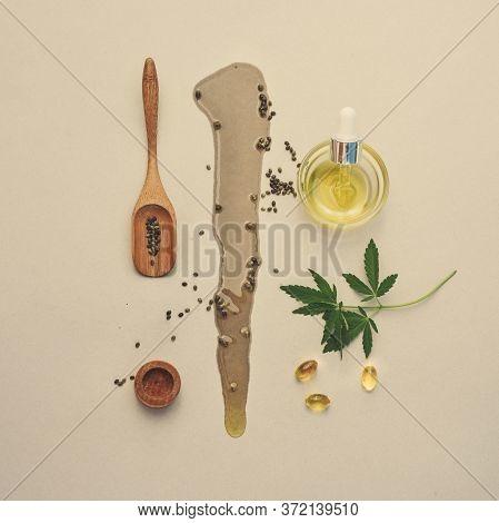 Cbd Oil, Tincture With Marijuana Leaves On A Beige Background. Blot Of Hemp Oil. Medical Cannabis Co