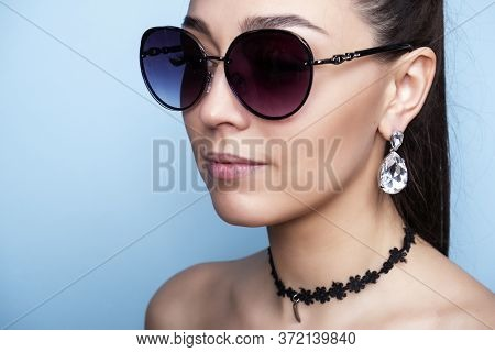 Girl In Glasses With Earrings. Photo Glasses And Earrings. Accessories For The Head.