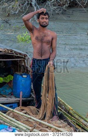Sundarbans, Bangladesh - November 14, 2016: Local Fisherman In His Boat In Sundarbans, Bangladesh