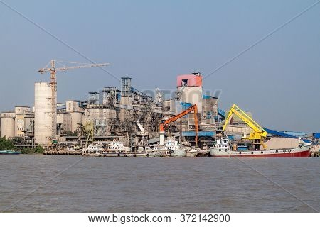 Mongla, Bangladesh - November 15, 2016: Cement Factory In Mongla Port, Bangladesh