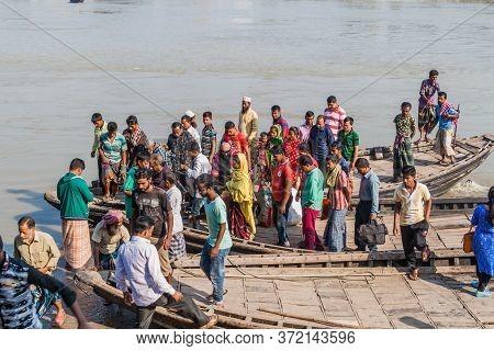 Khulna, Bangladesh - November 16, 2016: People Leave A Ferry On Rupsa River In Khulna, Bangladesh
