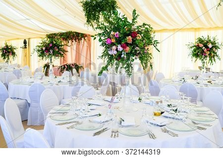 Flowers On The Serving Table Setting At A Banquet For A Reception Before A Large Reception