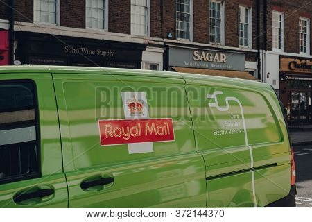 London, Uk - June 13, 2020: Close Up Of Green Electric Royal Mail Van On A Street In London. In Rece