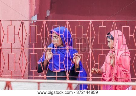 Bagerhat, Bangladesh - November 16, 2016: Two Women Behind A Fence Of Khan Jahan Ali Tomb In Bagerha