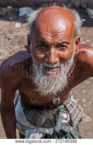 Bagerhat, Bangladesh - November 18, 2016: Old Man On A Bus Stand In Bagerhat, Bangladesh