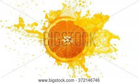 Fresh Orange Slice with Splashing Juice Isolated on White Background.