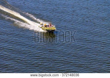 Kremenchug, Ukraine - July 2, 2017: Boat With Fishermen At The River Dnieper, Ukraine