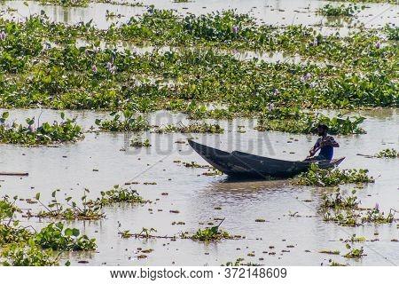 Balaswar, Bangladesh - November 19, 2016: Lone Man In A Canoe On Balaswar River, Bangladesh