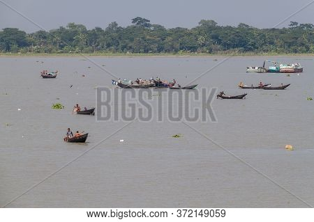 Katcha River, Bangladesh - November 19, 2016: Fisherman On A Small Boat On Katcha Kacha River, Bangl