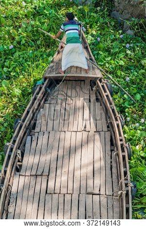 Katcha River, Bangladesh - November 19, 2016: Local Man On A Small Boat Stuck In A Vegetation On Kat