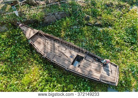 Katcha River, Bangladesh - November 19, 2016: Two Men On A Small Boat Stuck In A Vegetation On Katch