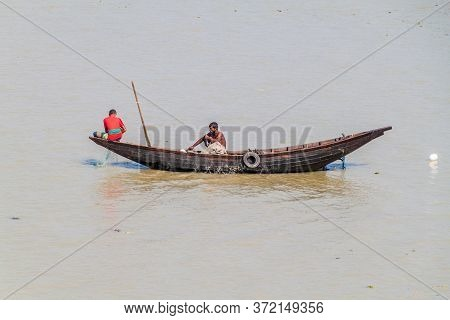 Katcha River, Bangladesh - November 19, 2016: Fishermen On A Small Boat On Katcha Kacha River, Bangl