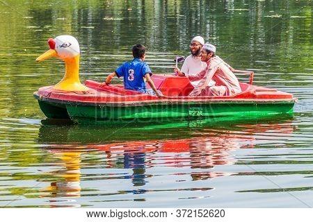 Sonargaon, Bangladesh - November 21, 2016: People Boating At A Pond Of Folk Arts Museum In Sonargaon