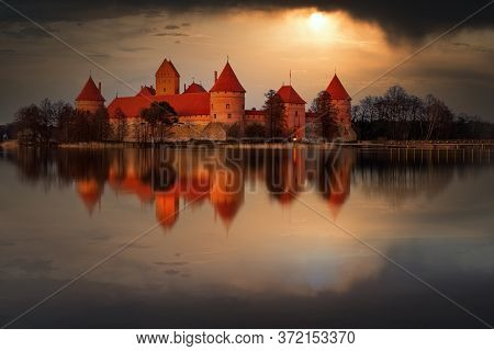 Trakai Island Castle In Lake Galve, Lithuania On Sunset With Dramatic Sky Reflecting In Water. Traka