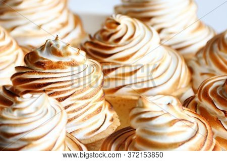 Lemon Meringue Tart Closeup On White Background. Lemon Curd Tart. Tasty Lemon Mini Meringue Pie