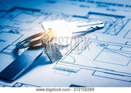 House keys on a house plan blueprint, still life.