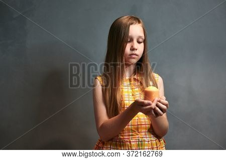 The Child Looks Thoughtfully At The Candle And Grieves