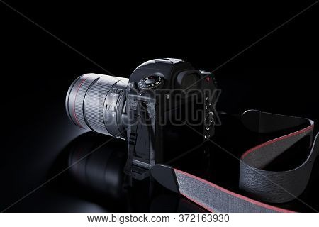 Professional Digital Slr Photo Camera With A Zoom Lens And A Leather Strap On A Black Background Wit
