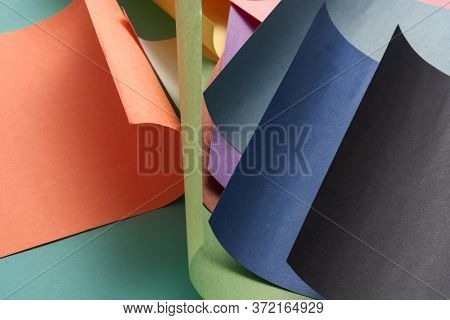 colorful luxurious wrapping papers on blue background.