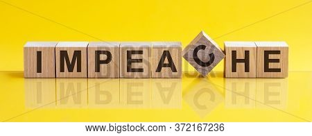 Impeache The Word Is Written On A Wooden Block. The Image Is Mirrored In The Glossy Surface. For You