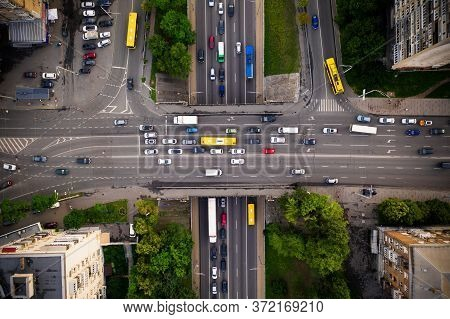 Road Traffic With Traffic Jam On A Highway Overpass, Top View. Two-level Intersection Of Perpendicul