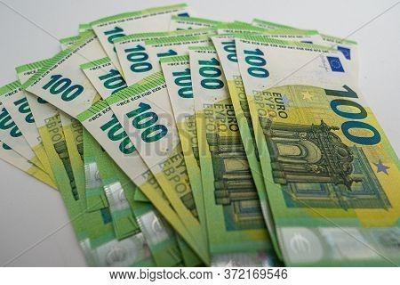 Big Amount Of Money - 100 Euro Bills On A White Background. High Quality Photo