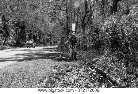 June 20, 2020 San Jose De Ocoa. Dramatic Black And White Image Of Dominican Man Doing Street Maintan