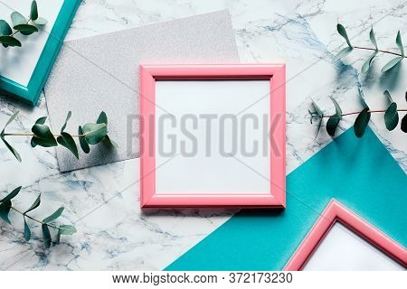 Beautiful Abstract Floral Background. Flat Lay, Top View Eucalyptus On Marble Background, Light Text