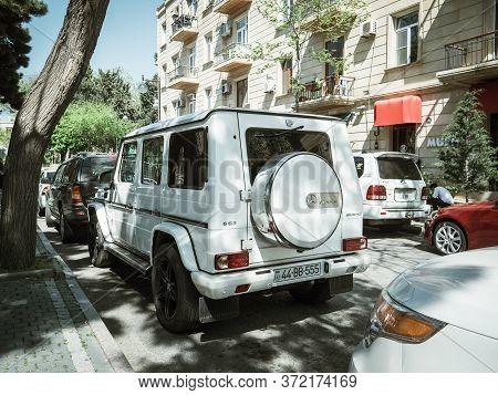 Baku, Azerbaijan - May 2, 2019: Luxury Mercedes-benz Amg G63 Parked Near Soviet Building In Central