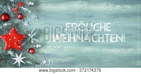 Christmas Background With Fir Twigs, Light Green And Red Trinkets And Silver Stars On Light Green Mi