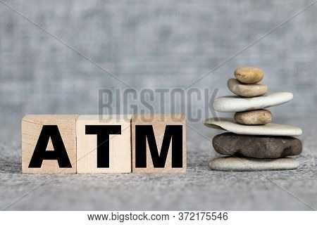 Wooden Cubes With Word Atm, Credit Cards And Coins On Table