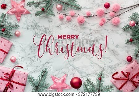 Text Merry Christmas . Panoramic Christmas Flat Lay On White Marble With Border Made From Wrapped Gi