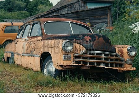 Old Abandoned And Forgotten Rusty Vintage Retro Car In Bad Condition.
