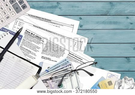 Irs Form W-4 Employees Withholding Certificate Lies On Flat Lay Office Table And Ready To Fill. U.s.