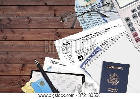 Irs Form 8302 Electronic Deposit Of Tax Refund Of 1 Million Or More Lies On Flat Lay Office Table An