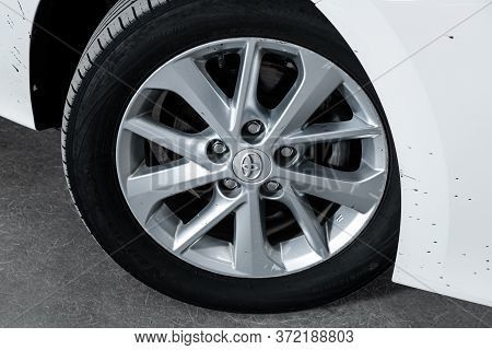 Novosibirsk/ Russia - April 22 2020: Toyota Corolla, Car Wheel With Alloy Wheel And New Rubber On A