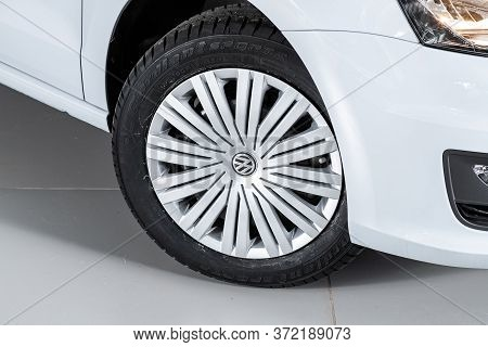 Novosibirsk/ Russia - March 15  2020: Volkswagen Polo,  Car Wheel With Alloy Wheel And New Rubber On