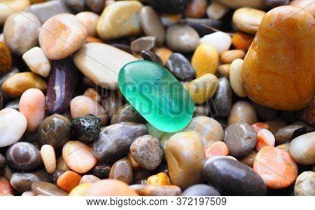 Pebbles And Gem Stones In Sea Shore