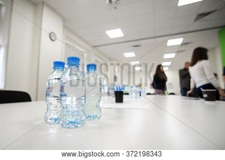 Water Bottles At A Meeting Of Colleagues In The Boardroom In The Office
