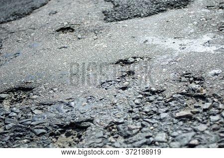 Semi-destroyed Bumpy Asphalt, Old Technology Of Road Production. Danger At High Speed. Holes, Pothol