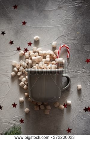 Scattered From A Small Pail Of Marshmallow On A White Background. Copy Space. Vertical View. Sweet A