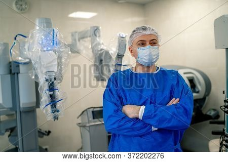 Surgical Room In Hospital With Robotic Technology Equipment, Machine Arm Surgeon In Futuristic Opera