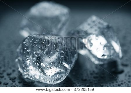 Close-up Of Ice Cubes On Black Background