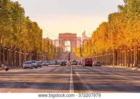 Paris, France - 9 September, 2012: The Champs-elysees And The Arc De Triomphe. The Most Famous Stree